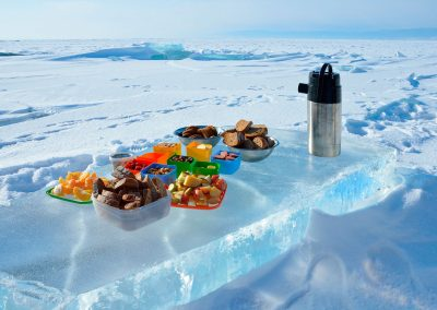 Food catering on Ice next to the coast of the North Lake Baikal. The Republic of Buryatia. Russia.